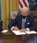 Biden signing an order
